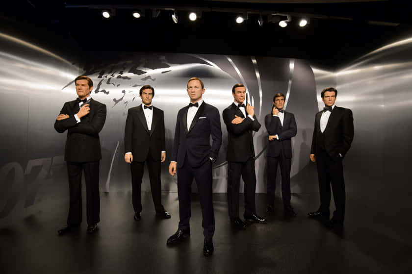 Mandatory Credit: Photo by Jonathan Hordle/REX/Shutterstock (5254361a) James Bond wax figures - Roger Moore, Timothy Dalton, Daniel Craig, Sean Connery, George Lazenby and Pierce Brosnan James Bond wax figures unveiled at Madame Tussauds, London, Britain - 15 Oct 2015 Madame Tussauds London today revealed wax figures of ALL SIX James Bonds, with five completely new wax 007s joining the existing figure of Daniel Craig. To coincide with the release of SPECTRE, the line up of Sean Connery, George Lazenby, Roger Moore, Timothy Dalton, Pierce Brosnan and Daniel Craig will appear at the Legendary London attraction for SIX WEEKS ONLY, before embarking on a tour of Madame Tussauds locations worldwide on December 1.